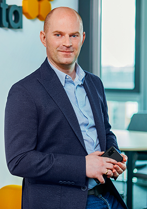 Mateusz Miernik in an office
