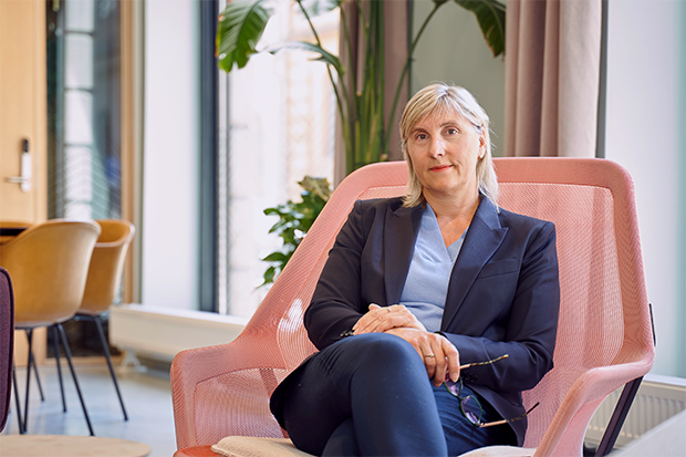 Cathrine Nagell sits in a comfy pink chair