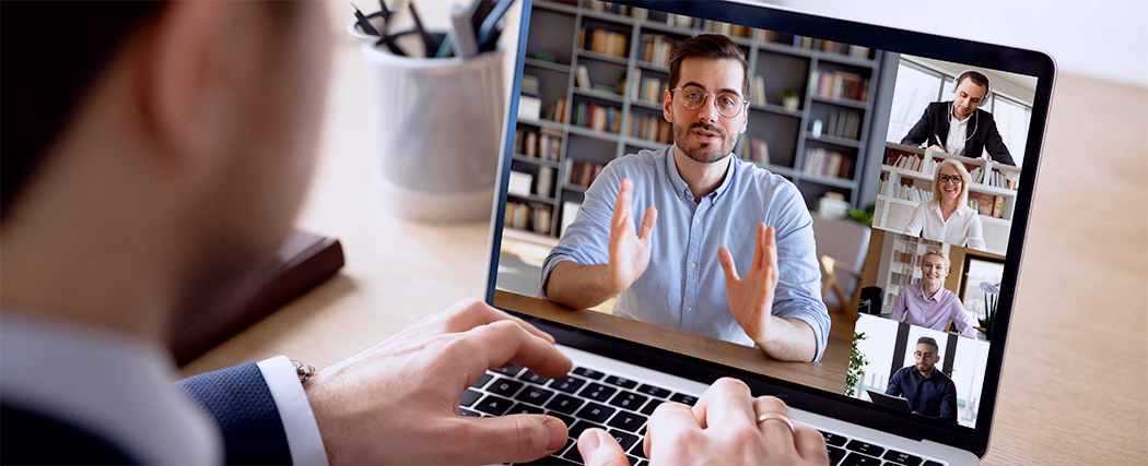 Laptop with an image of a consultant in a online interview